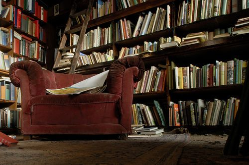 Not sure what I love more - the beat up chair, or the shelves filled with beautiful books.