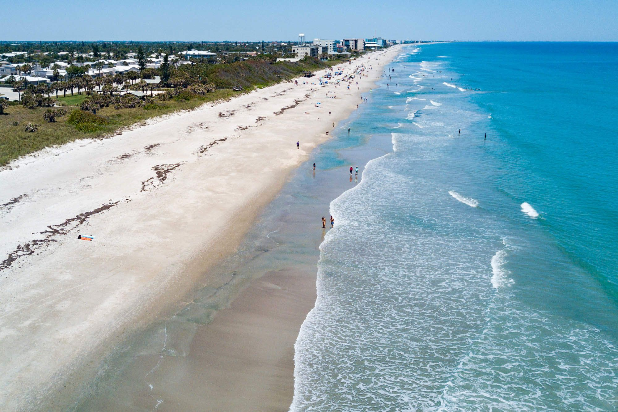 12 American Beach Towns You Can Actually Afford To Live In Beach Town Satellite Beach Florida American Beaches
