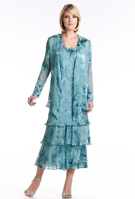 Capri by Mon Cheri. Two-piece silk burnout  A-line dress set with scoop neckline. Three-tiered ballerina length skirt with hand-beaded trim. Matching long sleeve jacket with beaded trim included.