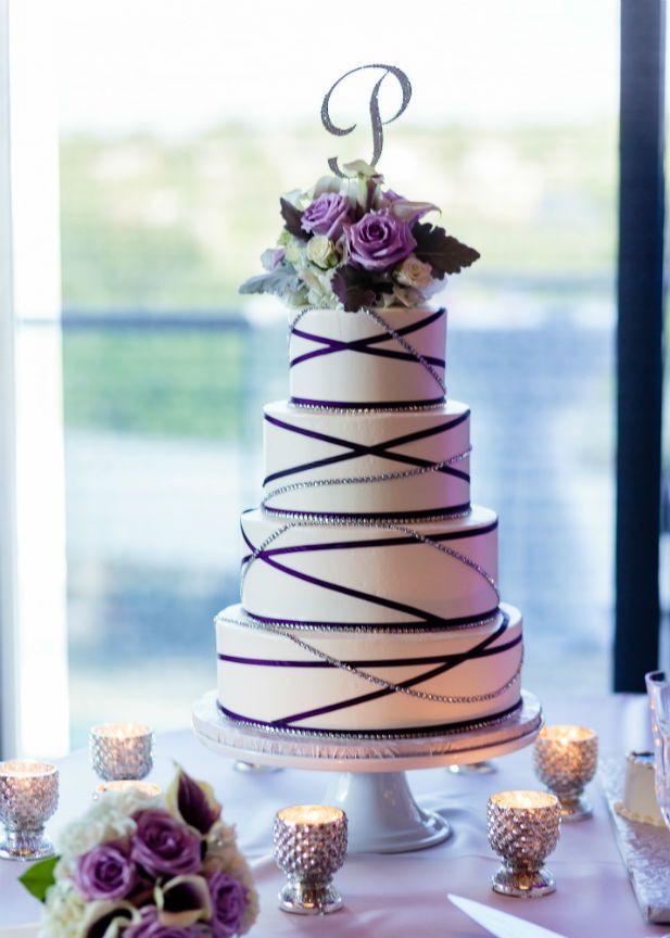 Romantic wedding at lakeway resort and spa pinterest white modern and romantic purple silver and white wedding cake with floral topper and sparkly monogram junglespirit Image collections