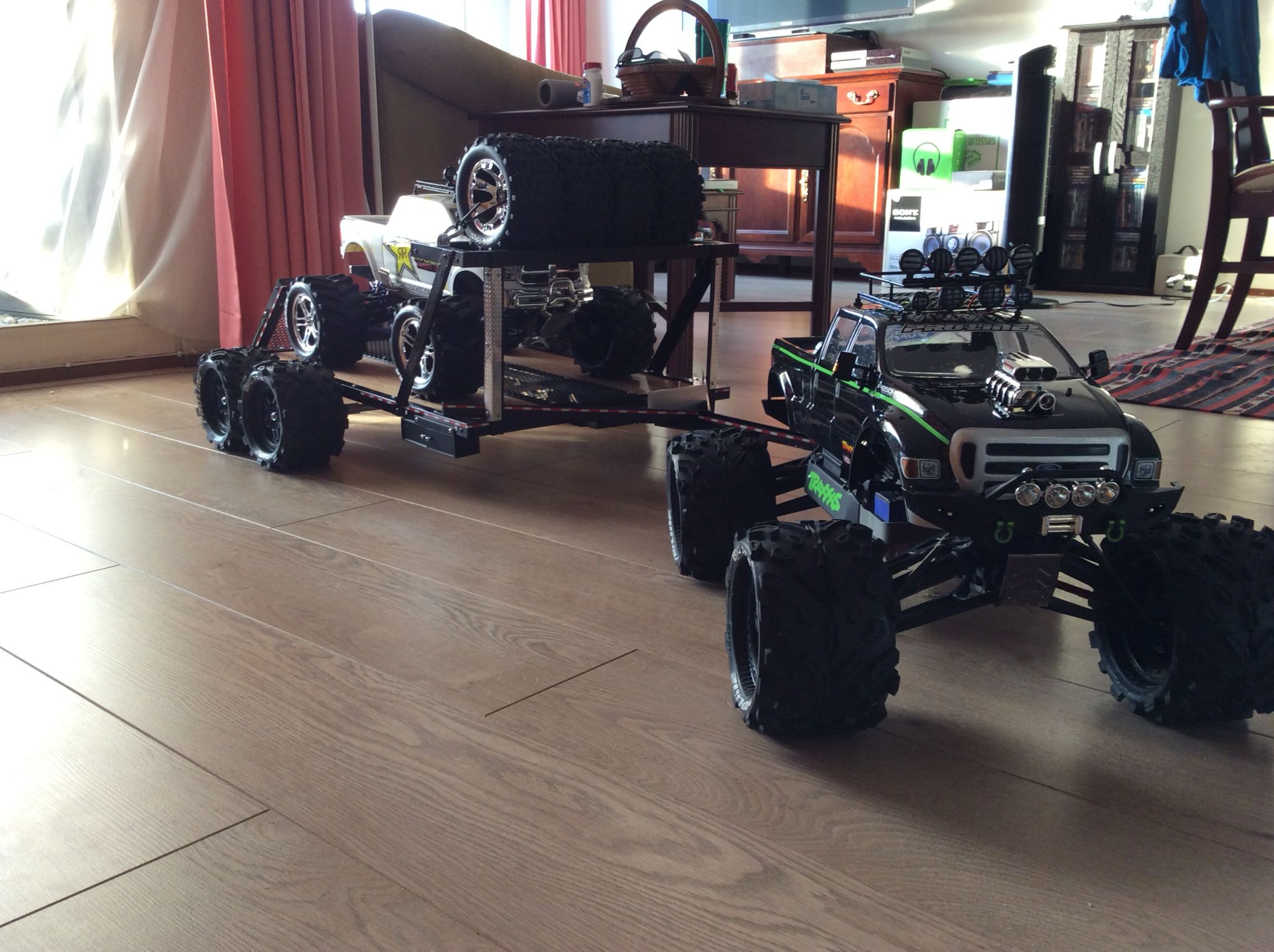 Custom Traxxas Summit w newly designed trailer and custom e Maxx on board
