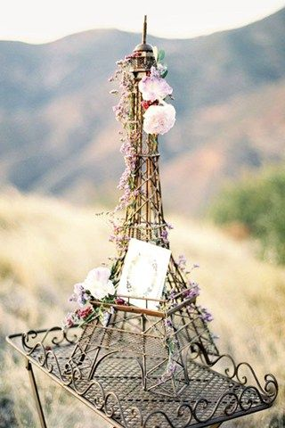 This Eiffel Tower with pink flowers would be the perfect centerpiece for a Paris or travel themed wedding