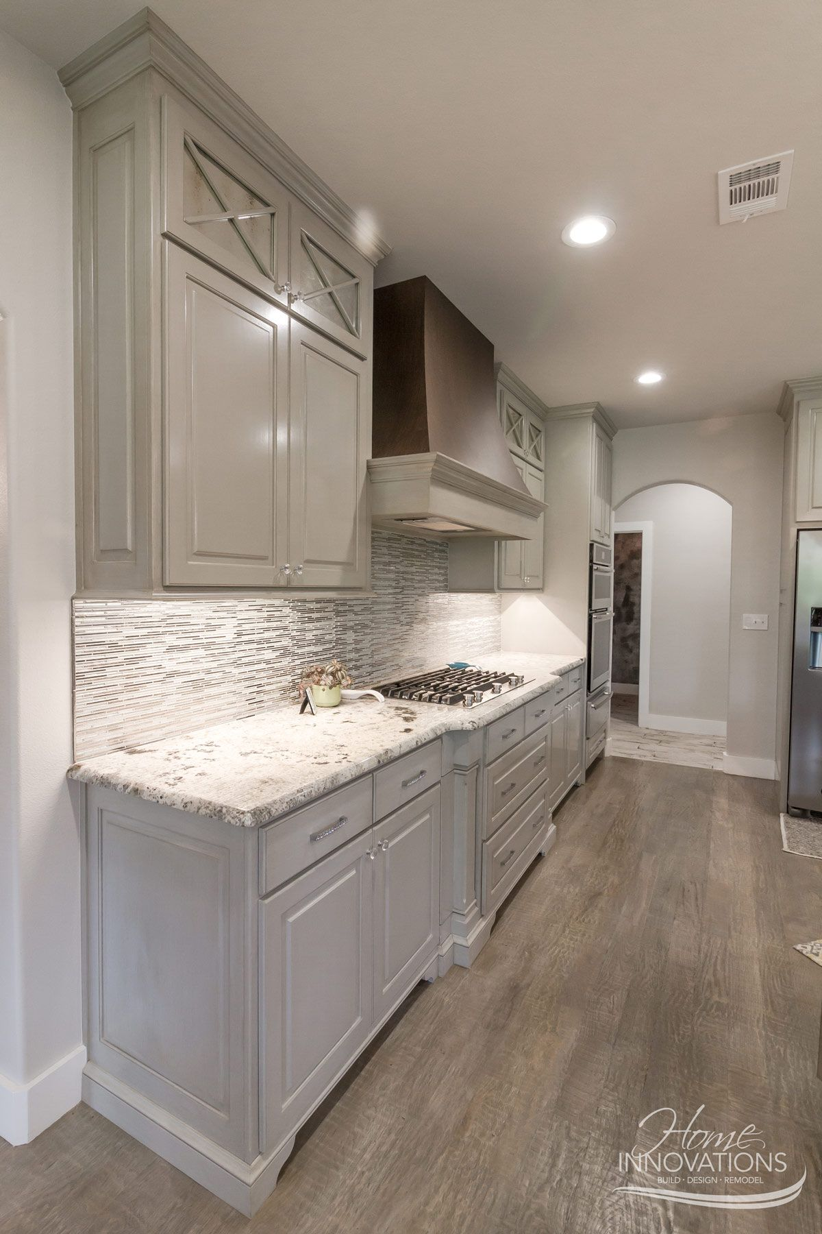 Custom Home Builder Tulsa Ok Rustic Glam Kitchen With Glass Tile Backsplash Granite Counters Metallic Strie Pai Glam Kitchen Taupe Flooring Taupe Kitchen