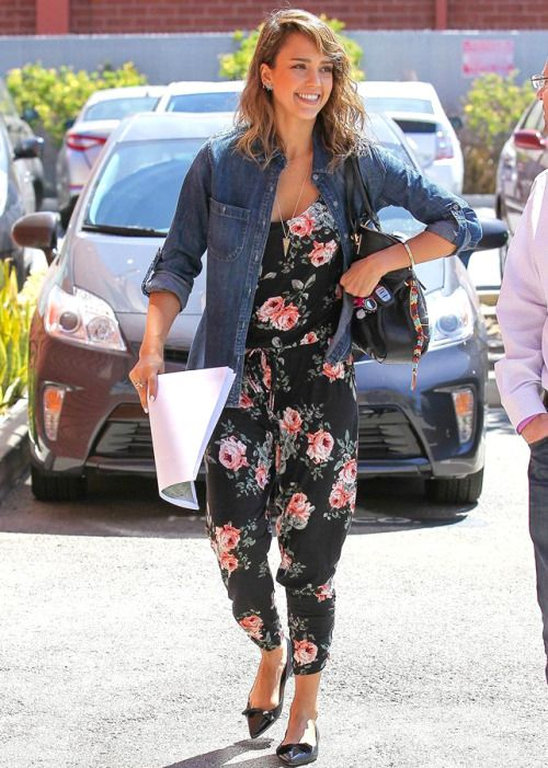Summer street style fashion: Jessica Alba in chambray denim shirt layered over vintage floral print jumpsuit.