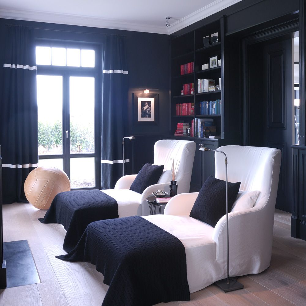 Room of the Day ~ fun concept - love these high backed curved chaises with navy throws facing fireplace, navy and white trimmed drapes- TH2 Hamburg 12.26.2013