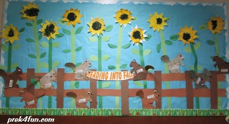 Heading Into Fall Bulletin Board: Preschool fall theme bulletin board. Easy preschool art Paper Plate sunflowers and Acorn painting Squirrels!