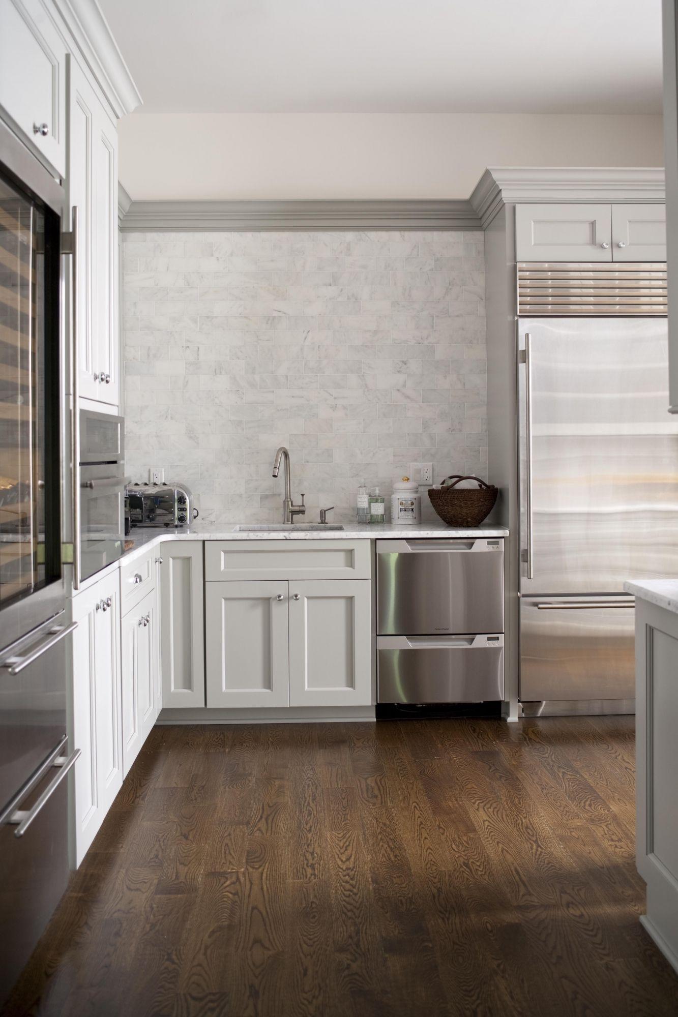Carrara marble as the countertops and subway tile backsplash from