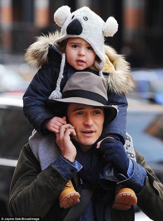 His little cuddly Koala: Orlando Bloom's son Flynn wore his favourite knitted koala bear beanie during an outing with his father in New York...