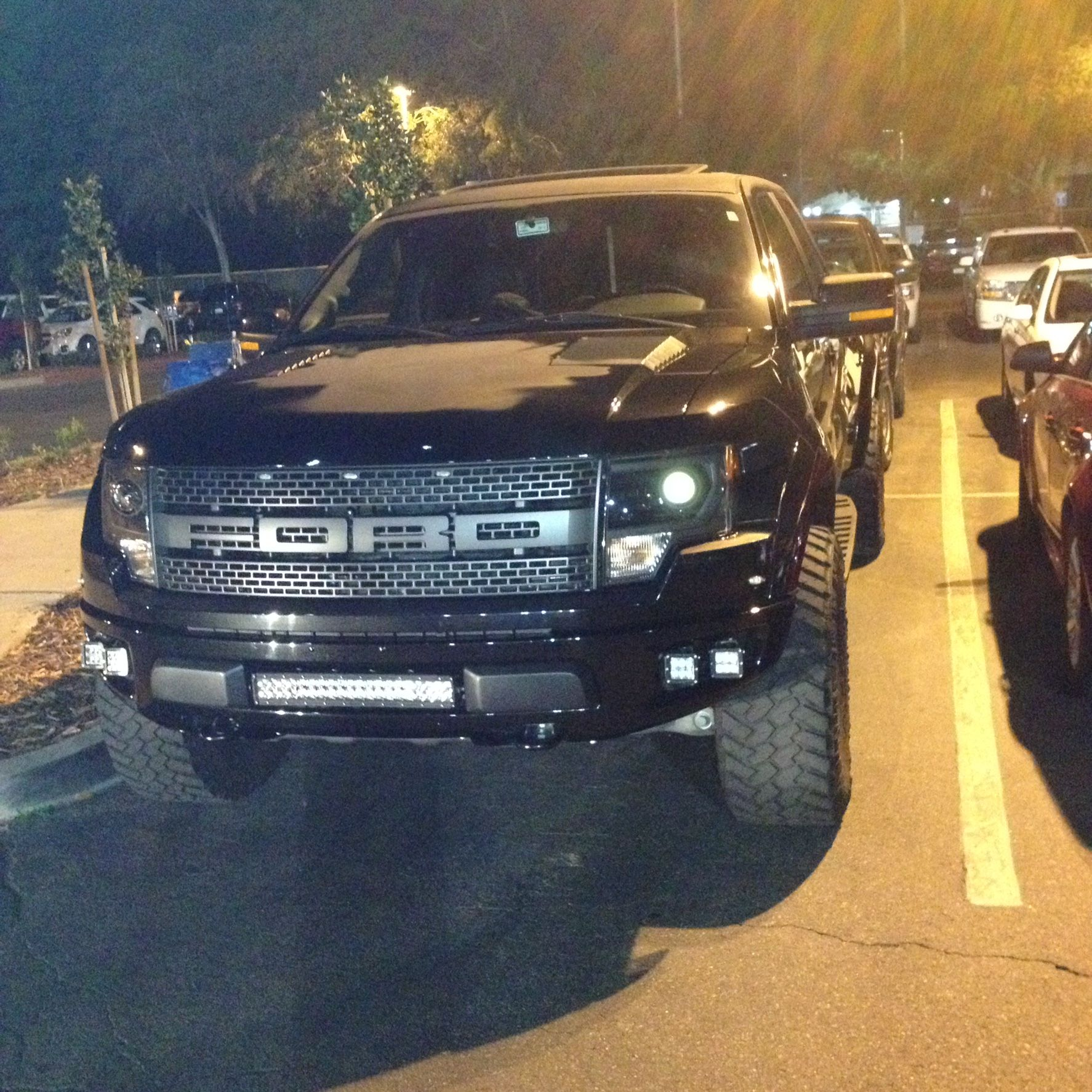 Saw This Beasty Ford Raptor Svt In The Parking Lot Ford Trucks Ford Raptor Svt Cool Trucks