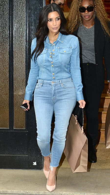 a7d3dcbb51 Kardashian wore head-to-toe denim while in Paris. Her nude pumps
