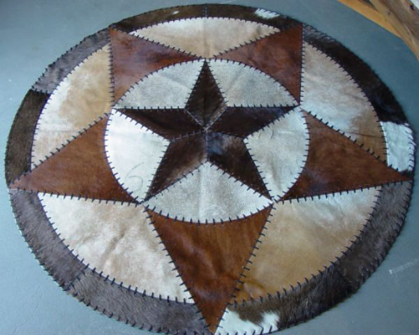 Hand Laced Round Cowhide Rug With Star 60 Inch