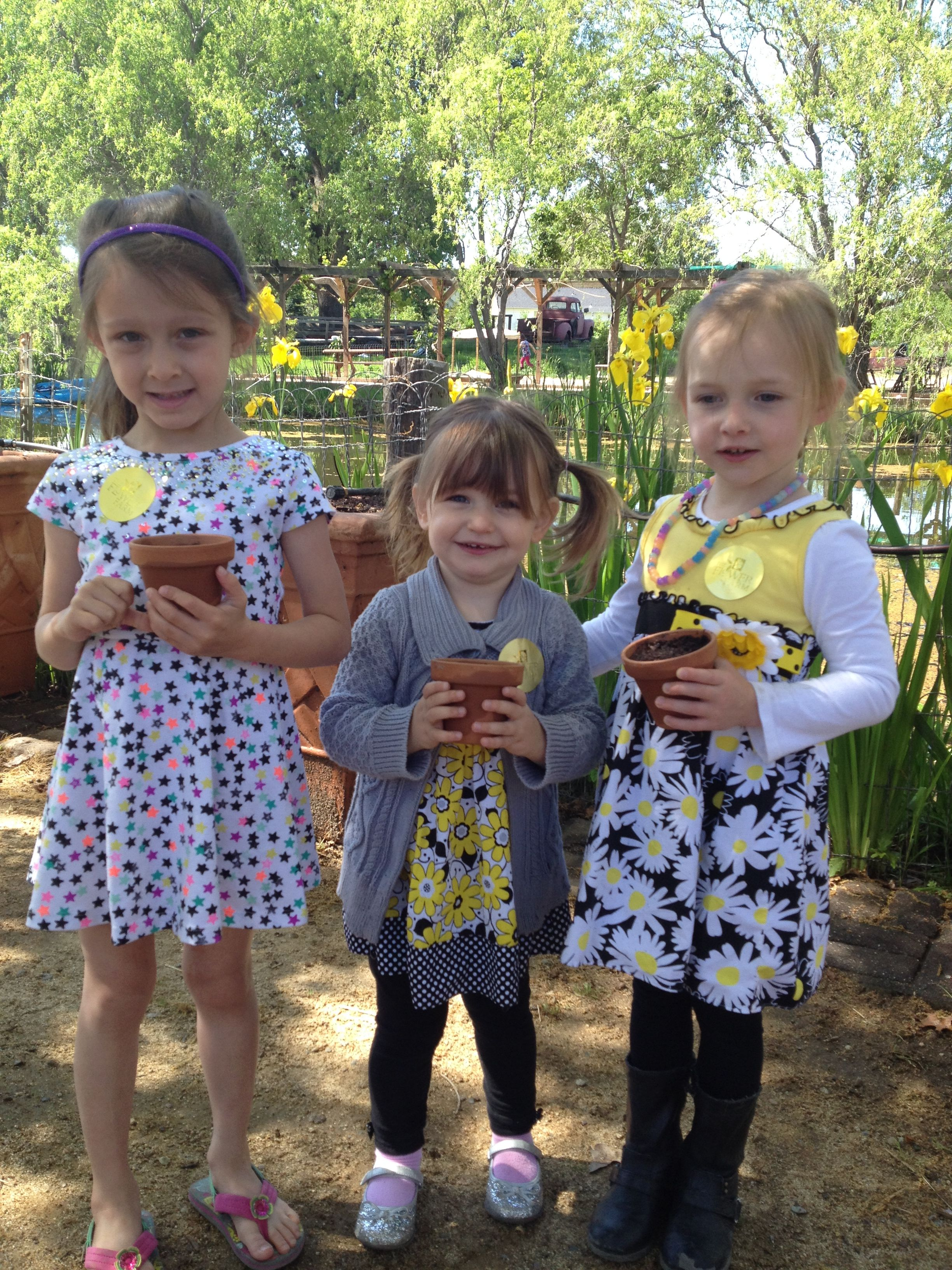 Little girls with their newly planted seedlings.