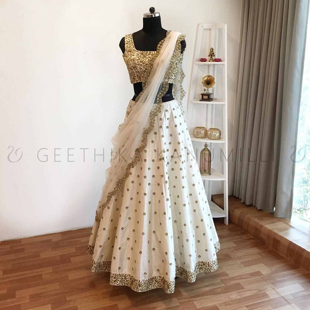 6c73d0368a Stunning white color lehenga and crop top with net dupatta. Lehenga with  hand embroidery butis