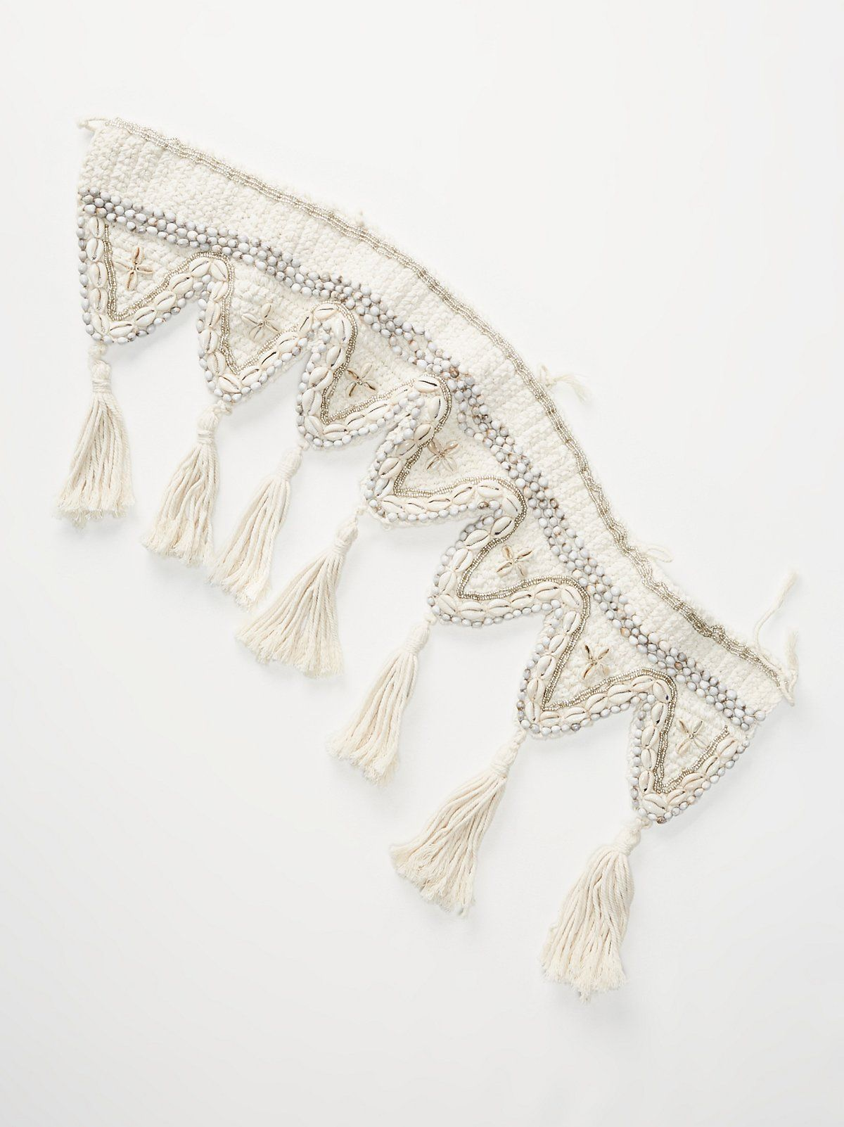 Ocean Bound Macrame Shell Garland | Add a beachy vibe to your holiday décor with this woven macramé garland featuring stunning bead and shell accents throughout. Large tassels hang from the trim.