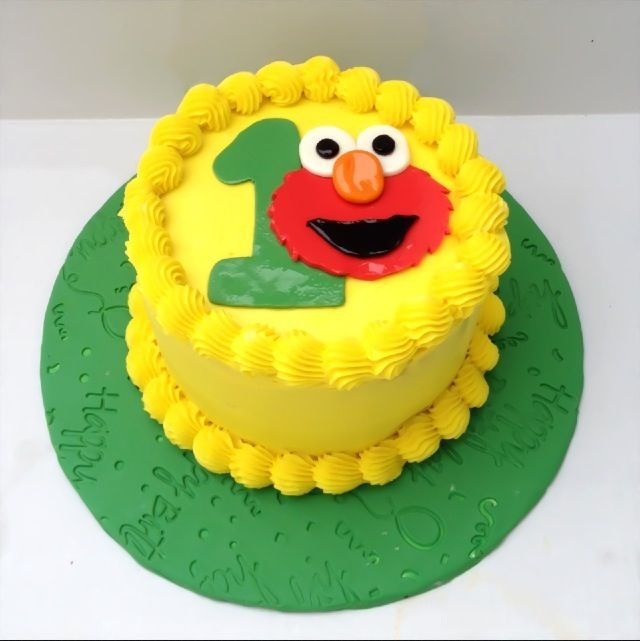 Elmo Smash Cake but maybe more colors than just yellow lets