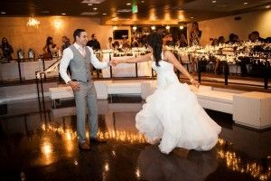 Our large, sunken dance floor gives great space for your first dance, and ensures everyone will have a good view! Sarah Hill Photography. Weddings at Curtis Ballroom at The Landmark, Greenwood Village, Colorado.