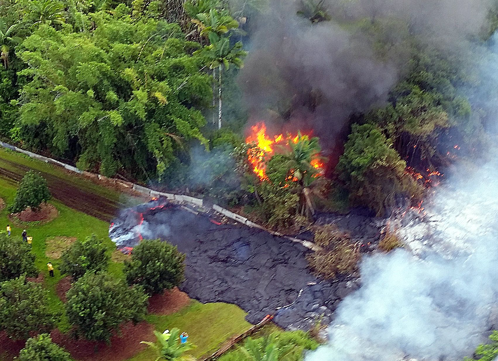 In this Oct. 28, 2014 photo provided by Pete Stachowicz of Paradise Helicopters, a house burns to th... - AP Photo/Pete Stachowicz, Paradise Helicopters