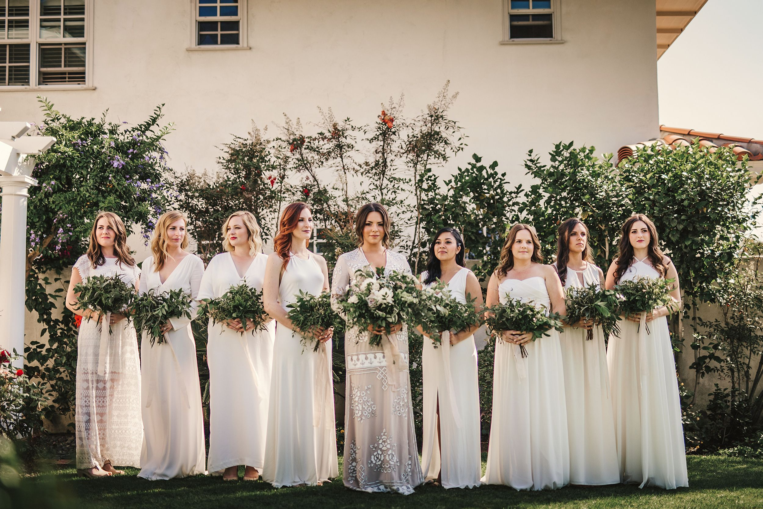 Green and white wedding dress  A beaded BHLDN wedding gown and mismatched white bridesmaid dresses