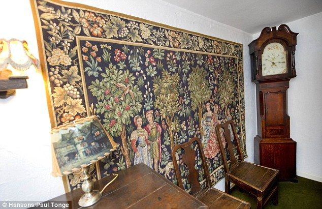Craftsmanship: The Carolean-style wall hanging depicts figures in a wood