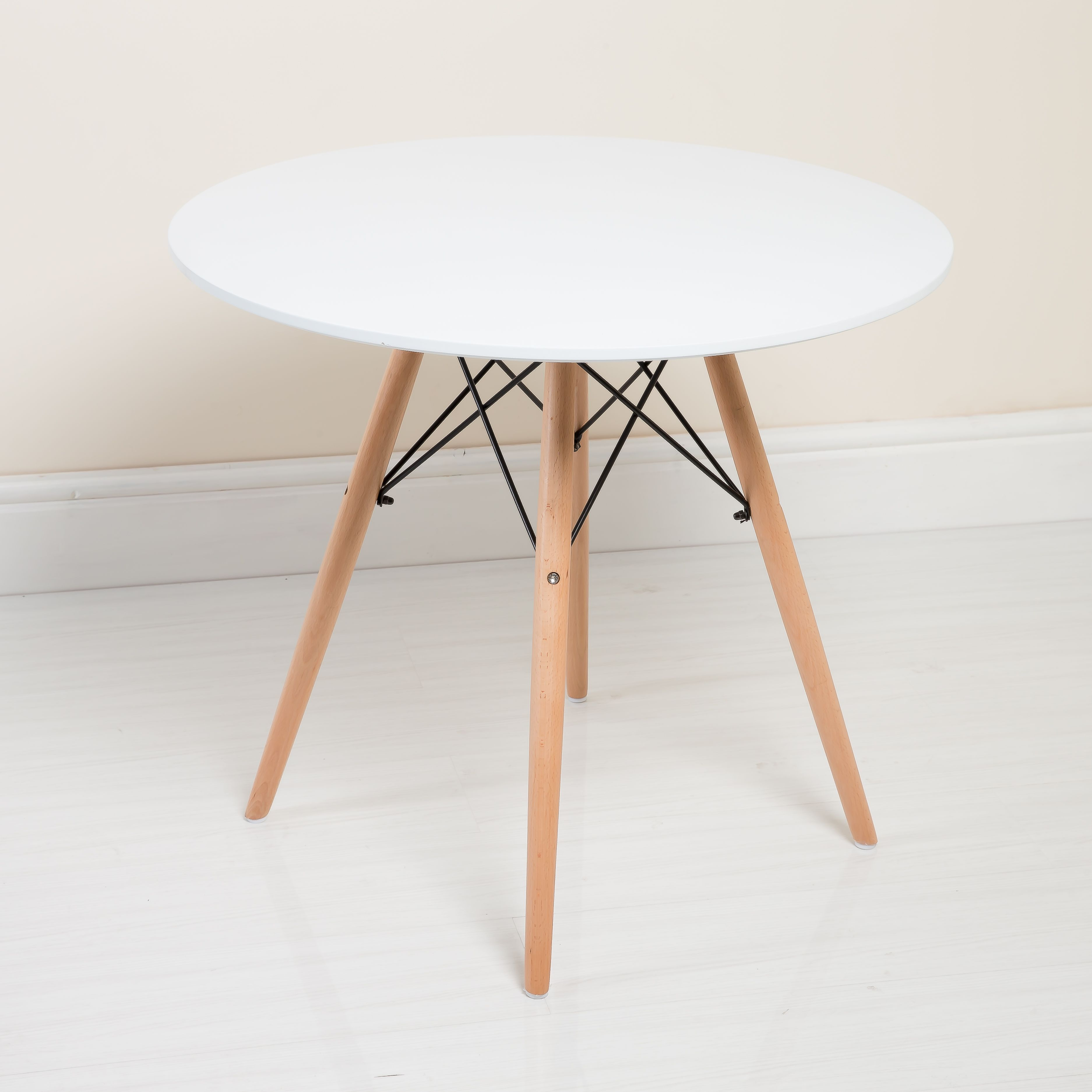 Bring a classic minimalist look to your kitchen or dining room with this Charles Eames inspired table from Abreo. #CharlesEames #Table #White http://abreo.co.uk/kitchen-furniture