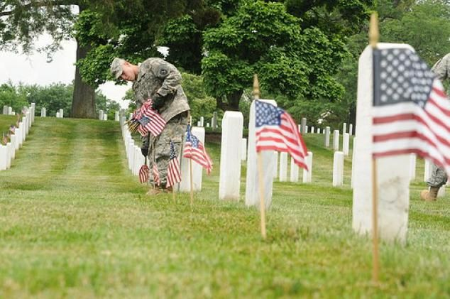 Guard Soldiers honor fallen with flags at Arlington graves...... THIS... is the price of our freedom..... ALL of these lives LOST.... so you can live yours..... Remember that!
