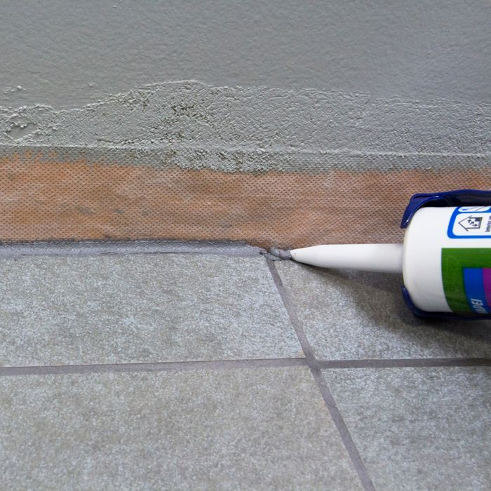 Applying Grout Sealer to the Joints.   Tile floor diy