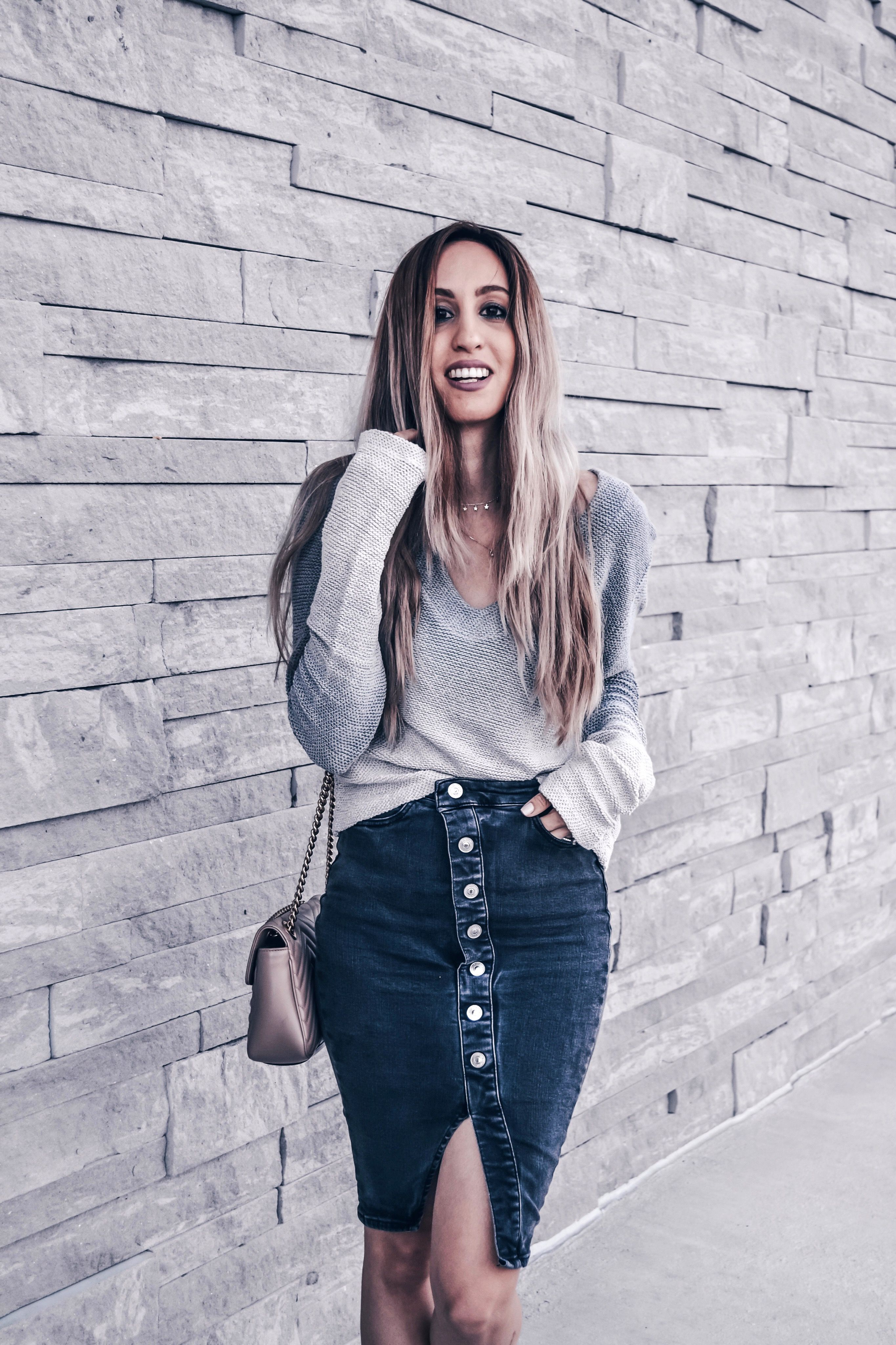 Love sweaters and knits paired with denim skirts! Black