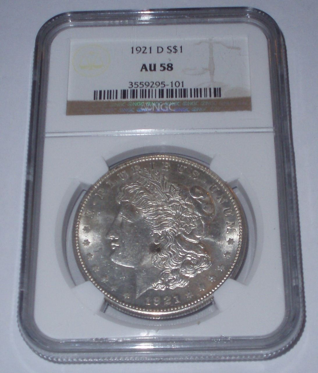 1921-D Morgan Silver Dollar NGC AU 58, $41.00 With Free