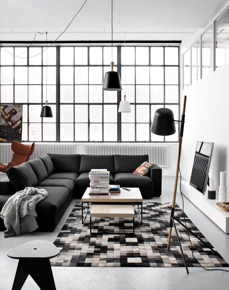 black, white, wood decor in copenhagen studio apartment