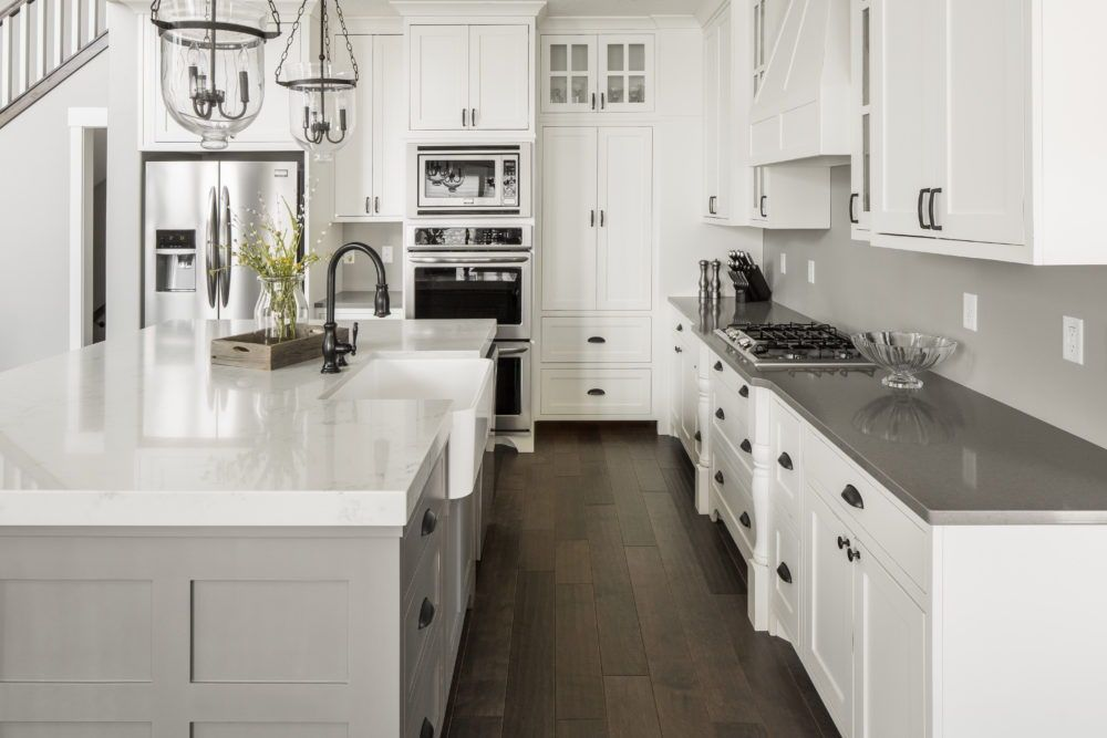 We Love The Contrast In These White And Grey Countertops The Two Different Colors Is A Kitchen Remodel Countertops Quartz Kitchen Countertops Grey Countertops