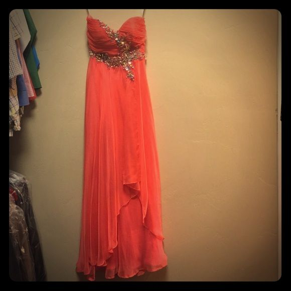 "Gorgeous tangerine/coral prom dress. Prom dress.  Worn once.  A couple of small snags in overlay, but nothing that flaws the dress.  The girl in the photo is 5'3"". Cinderella Dresses Prom"