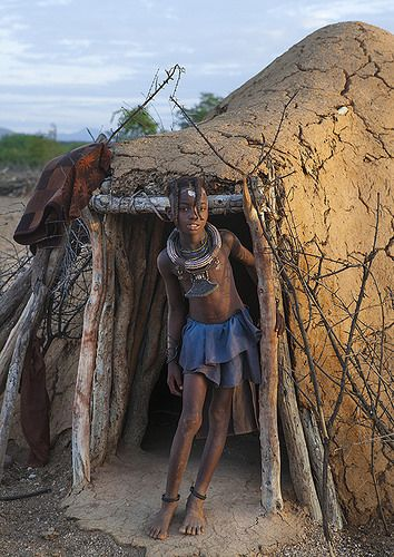 Girl Of Himba Tribe Standing In Door Of Shack, Epupa