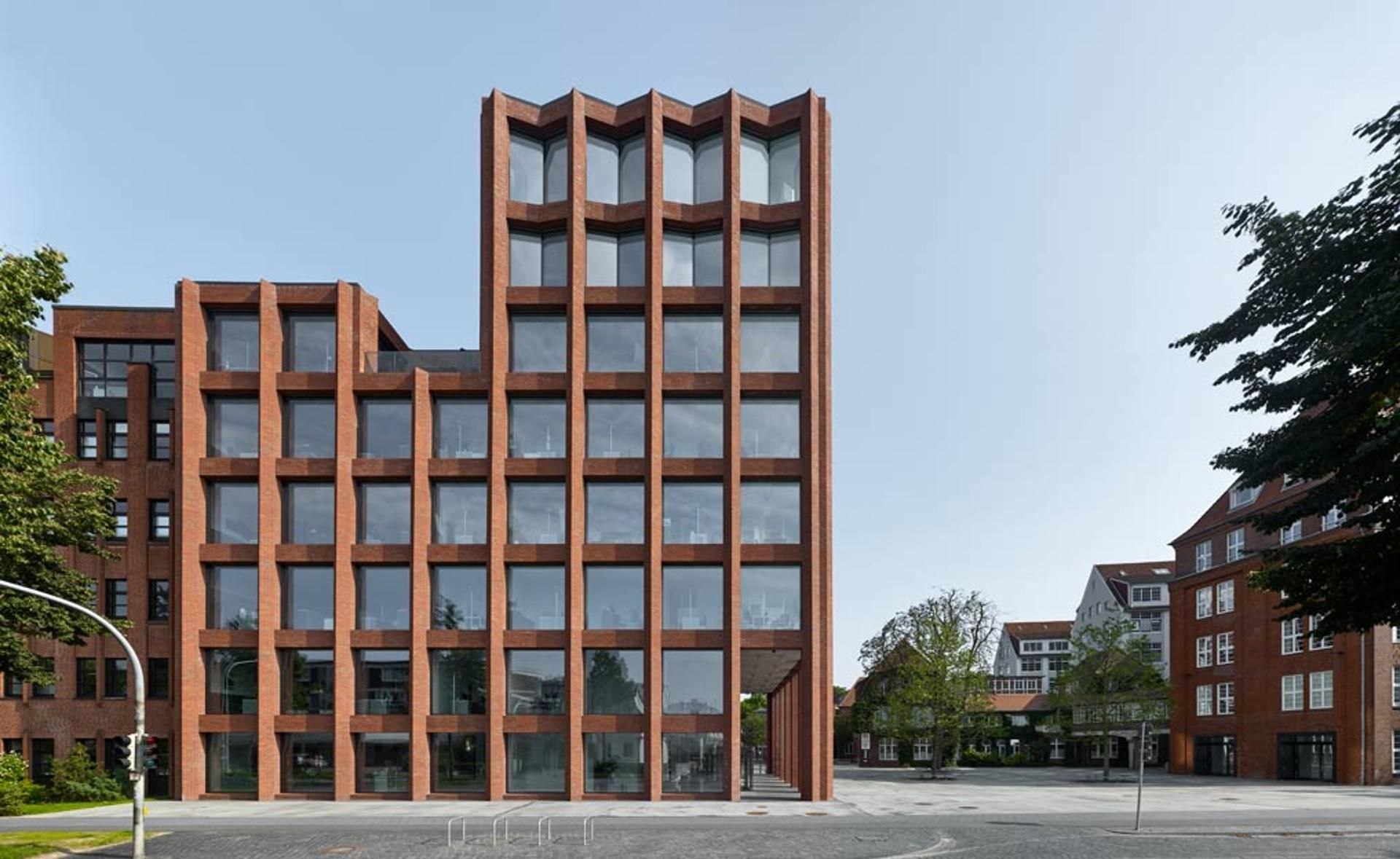 Red Brick Glass Building Modern Front View Reception Building Drager Germany In 2020 Facade Architecture Design Facade Architecture Glass Building
