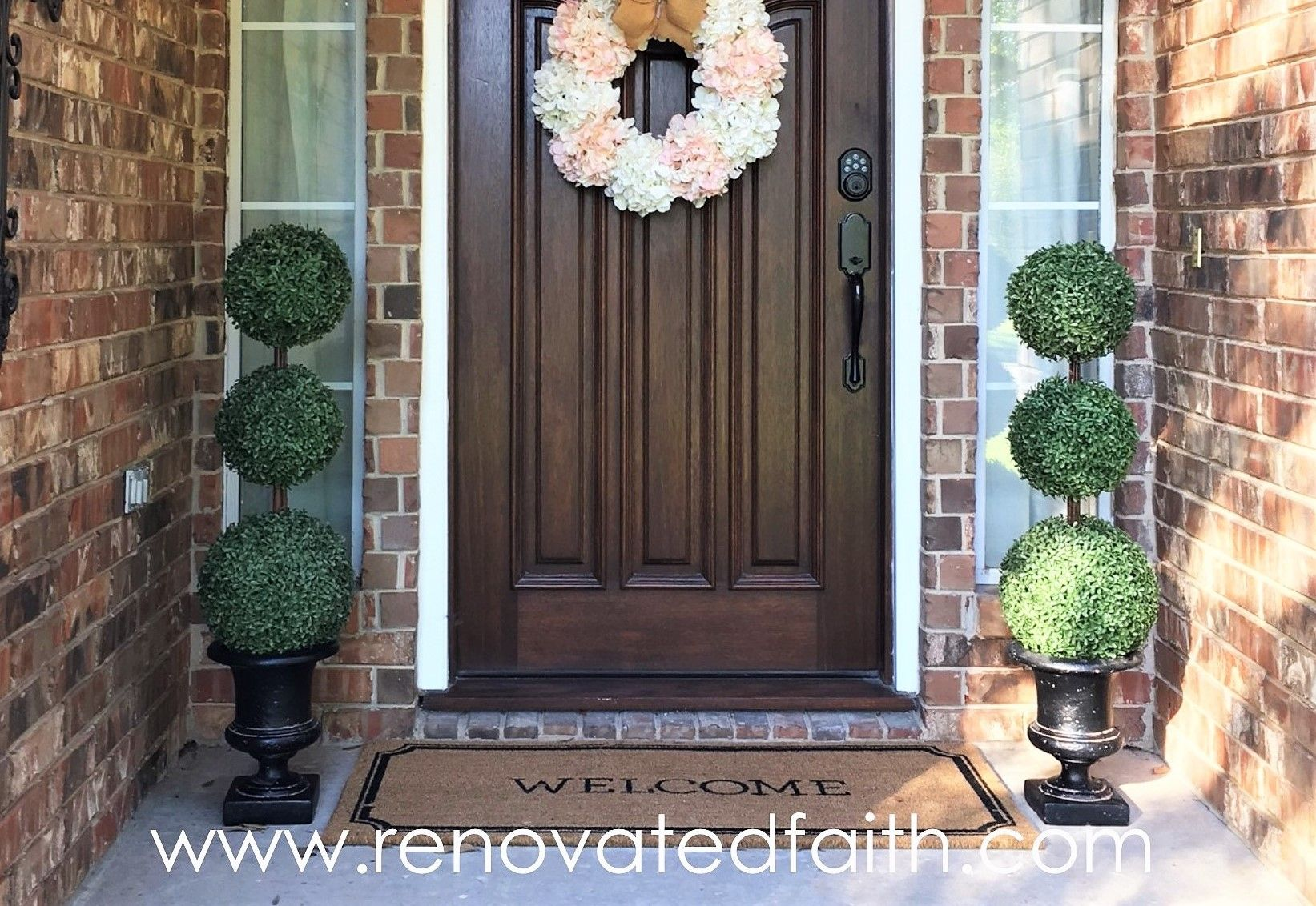 My Topiary Trees Have To Be One Of My Favorite Diy Projects To Date They Make Such An Inviting Statement On Topiary Trees Front Porch Decorating Porch Topiary