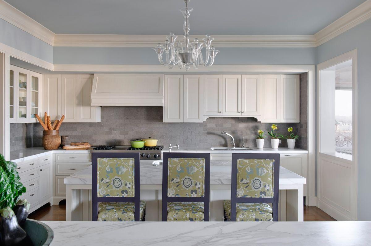 White kitchen cabinets, blue walls, chandelier