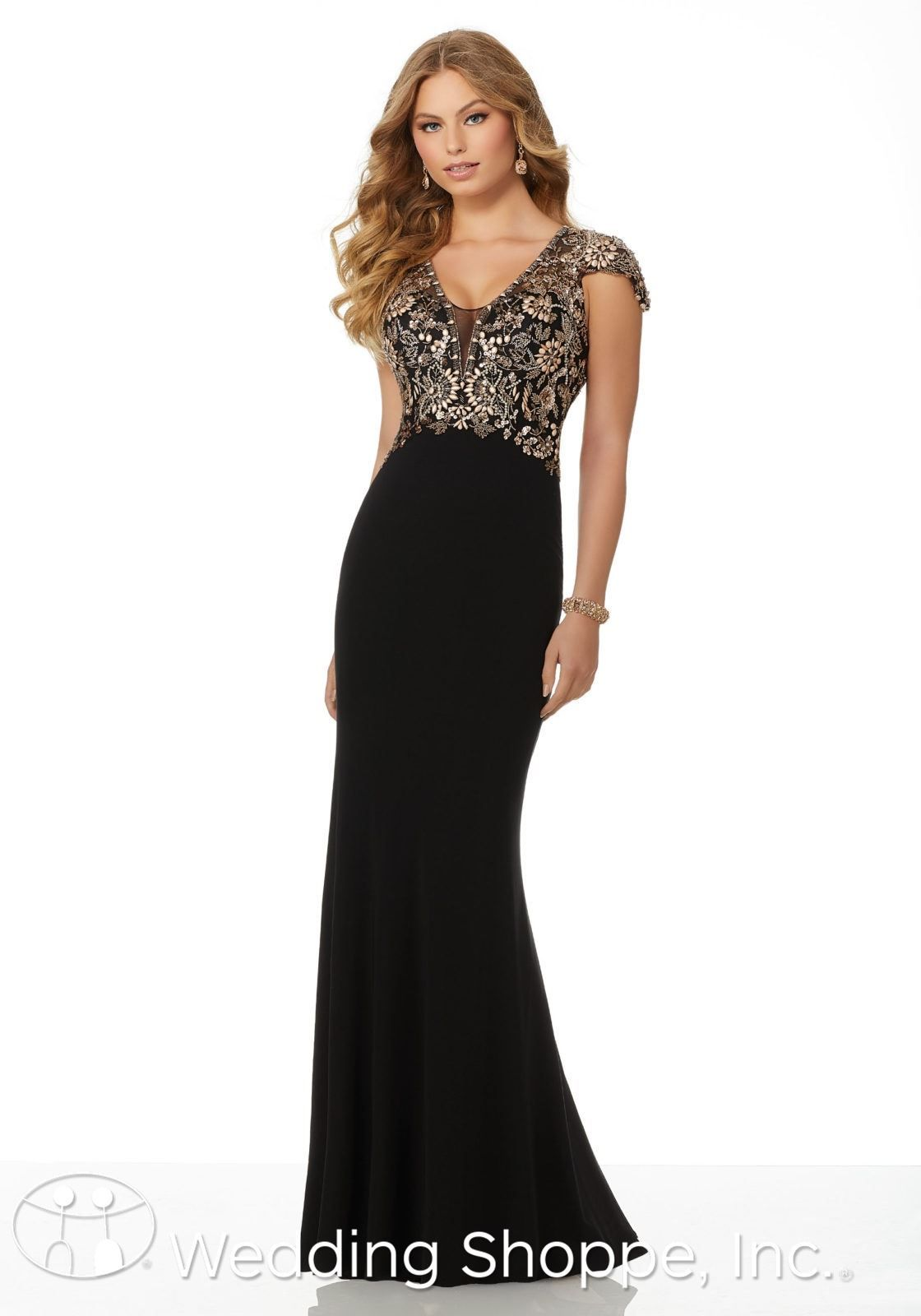b0361f847eb Slim and form-fitting beaded prom dress with a partially open back
