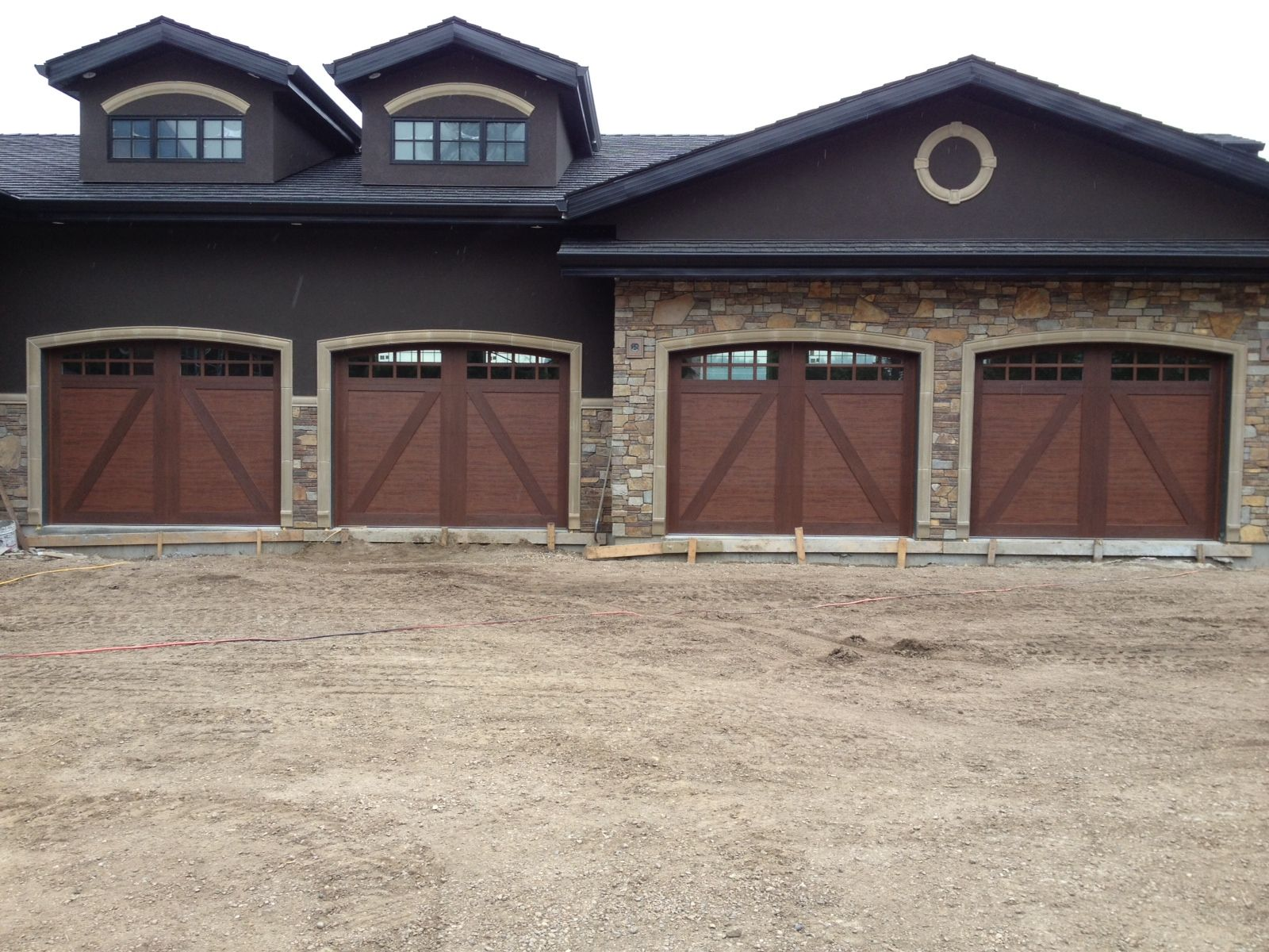 These Are The Clopay Canyon Ridge Ultra Grain Collection 10 X 8 Door In Walnut Finish With Ar Garage Doors Carriage Style Garage Doors Composite Garage Doors