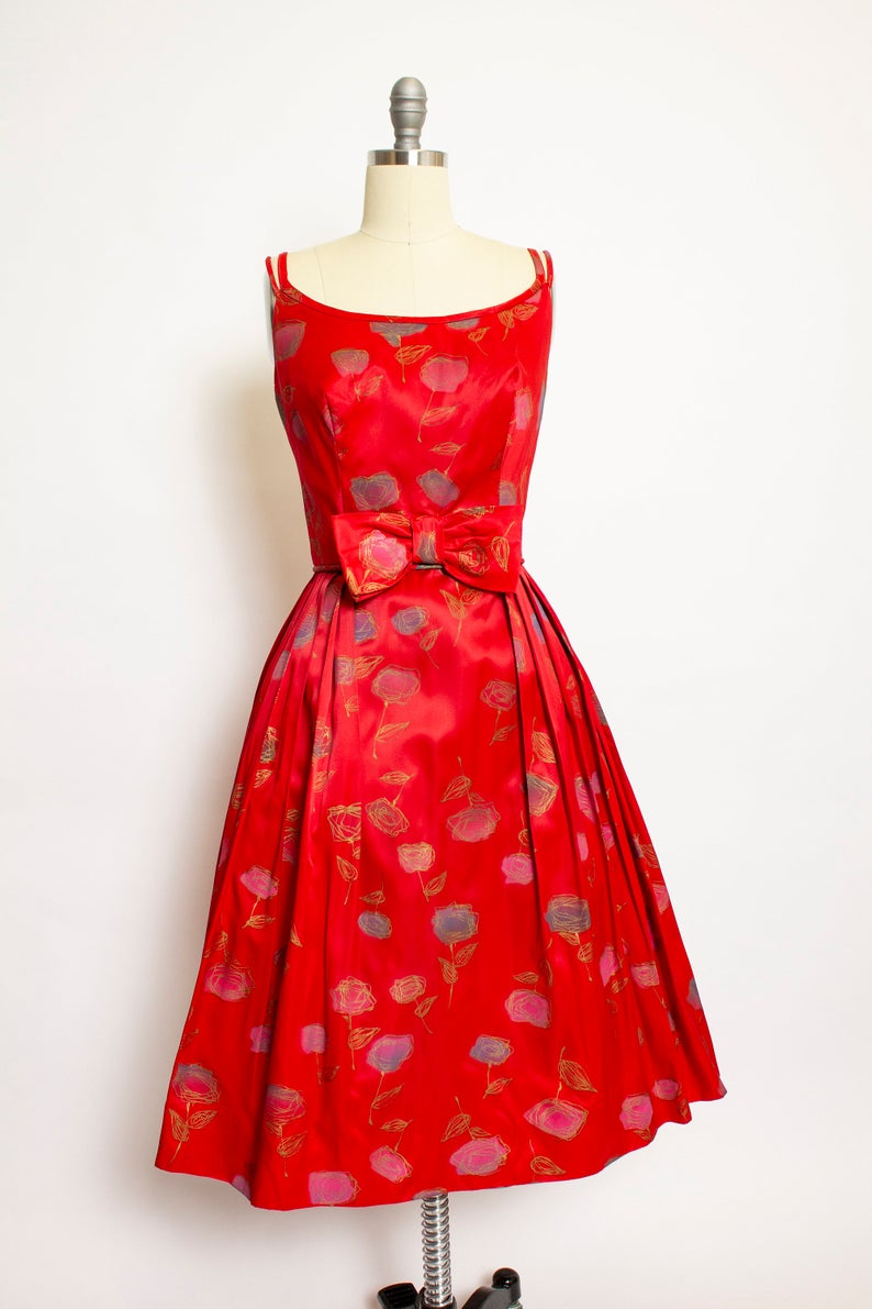 Vintage 1950s Dress Red Satin Rose Gold Printed Bow Full Skirt 50s Small S - Vintage 1950s dresses, 1950s party dresses, Vintage dresses online, Vintage outfits, Vintage style dresses, Vintage dresses 50s - dejavintageboutique  Follow us on Instagram @dejavintage for exclusive first looks and offers
