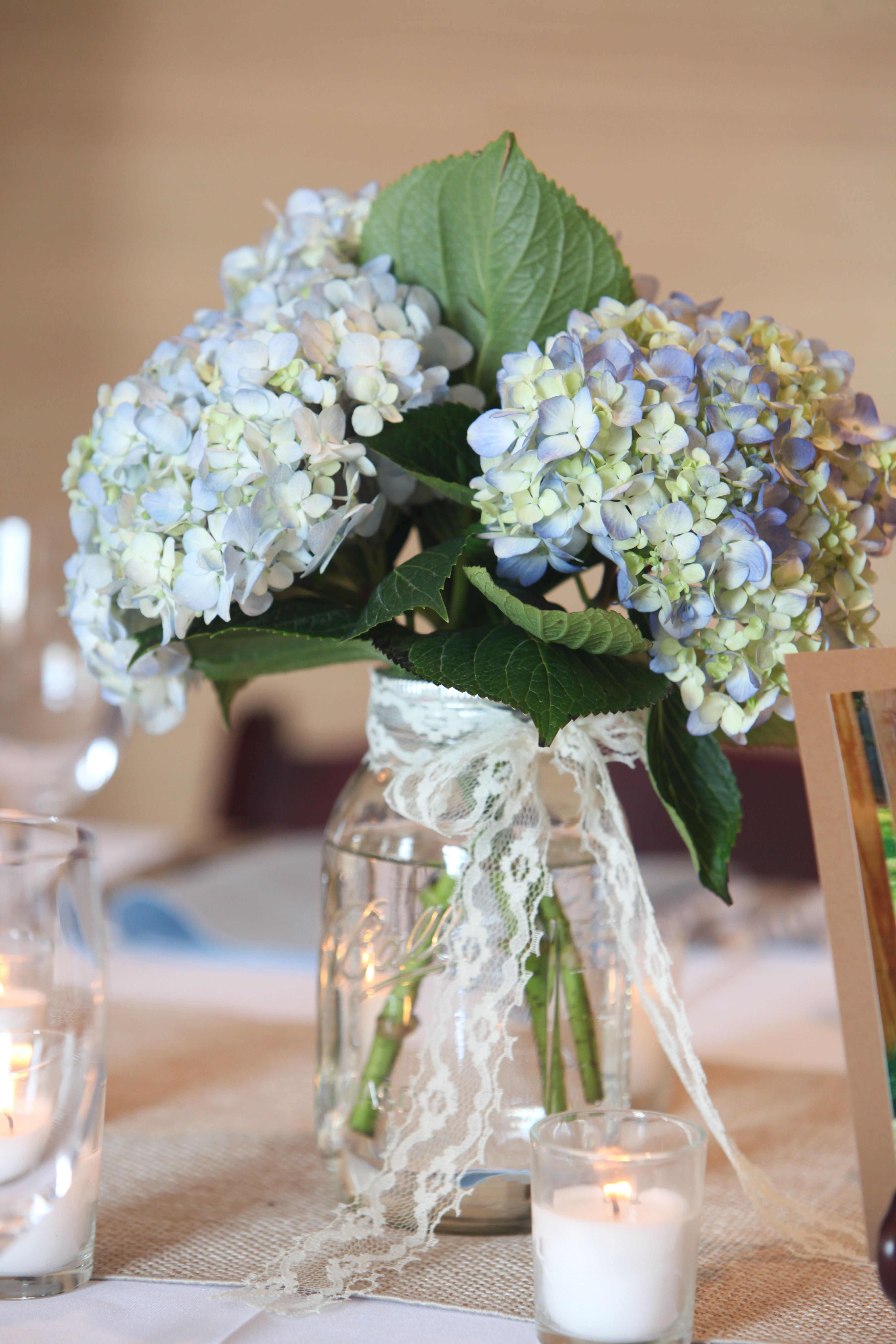 Blue hydrangea with lace in mason jar designed by judy