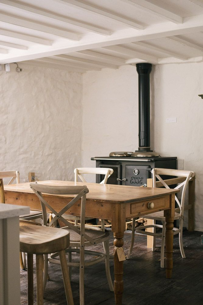 Wooden table and cross back chairs at our Cotes Mill Showroom