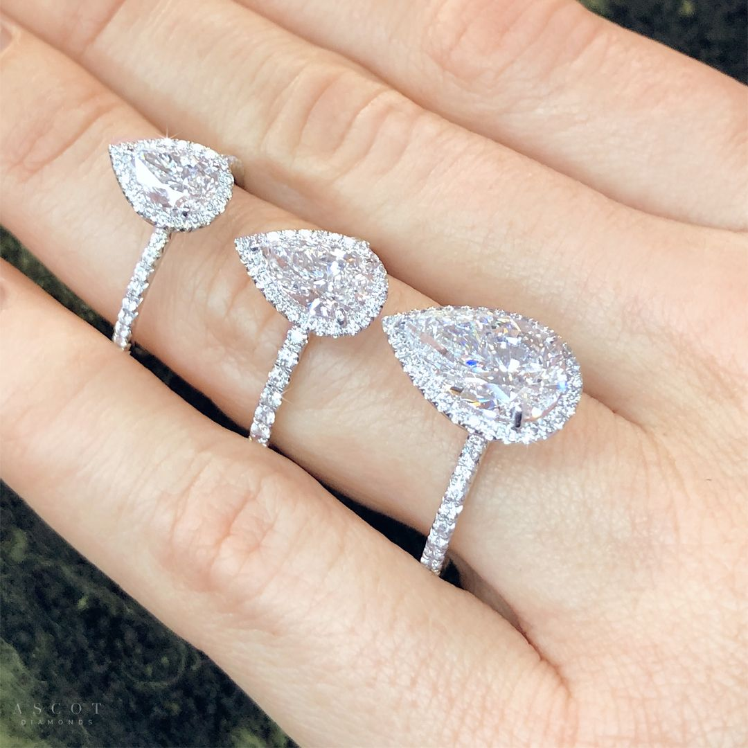 """The pear shape diamond has also been referred to as the """"teardrop"""" diamond.  For a unique and stunning diamond engagement ring, select an elegant pear shape diamond set on a custom halo style ring.  Visit one of our showrooms to Design your own engagement ring by Ascot Diamonds.   #ascotdiamonds #pearshapediamond #engagementrings"""