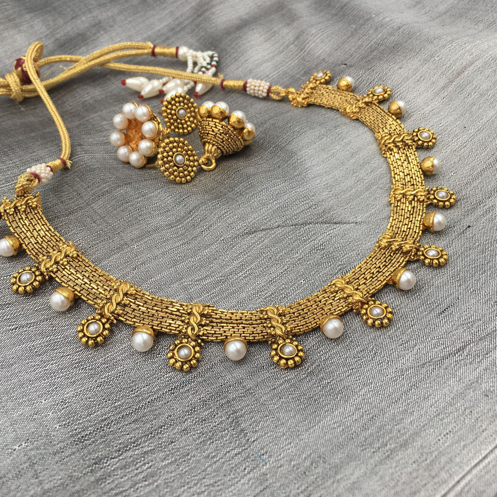 Golden fit necklace with moti and small flowers