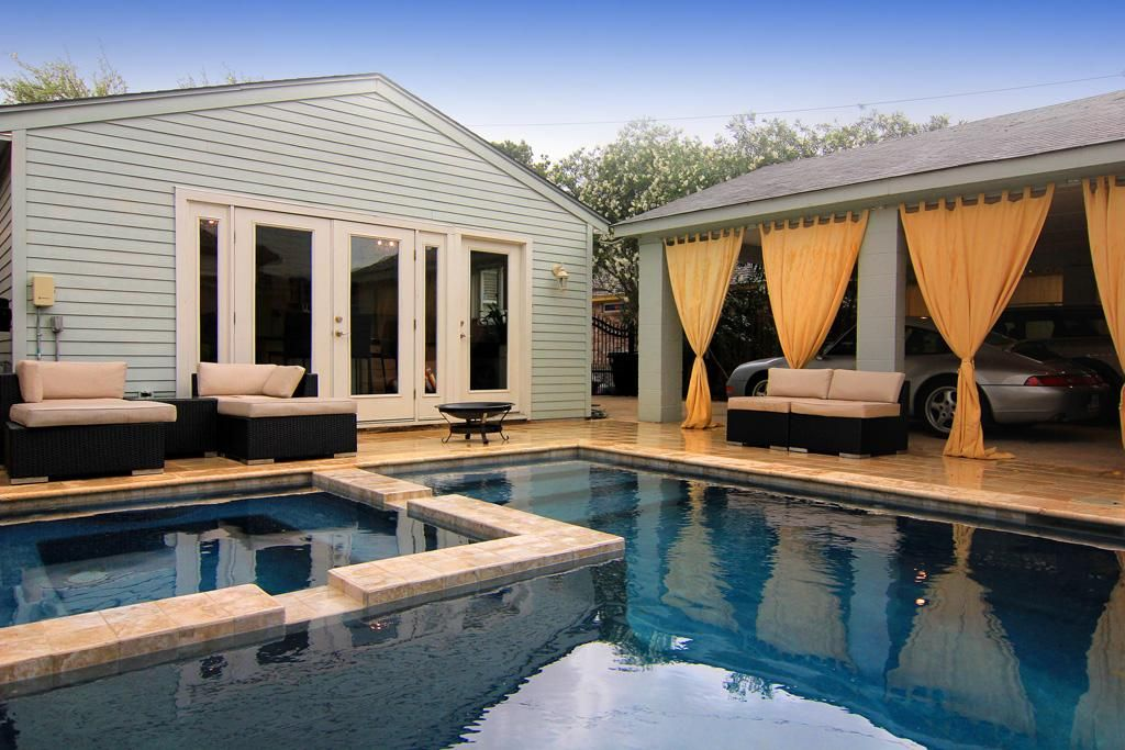The back yard is an OASIS! pool and retreat for