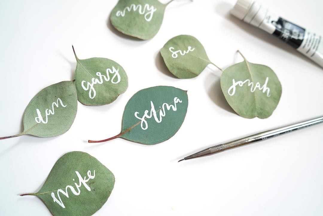 Lettering On Eucalyptus Leaves Fun Place Cards Wedding Place Cards Wedding Centerpieces Wedding Engagement