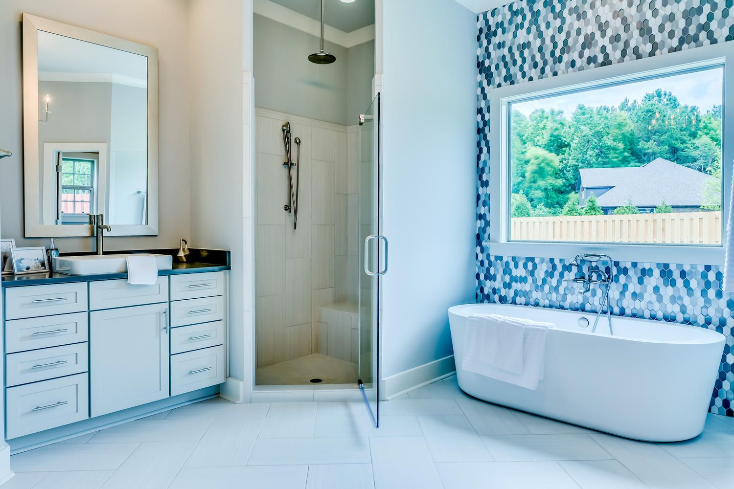 Stunning bathroom with light grey walls along with a spacious vanity ...