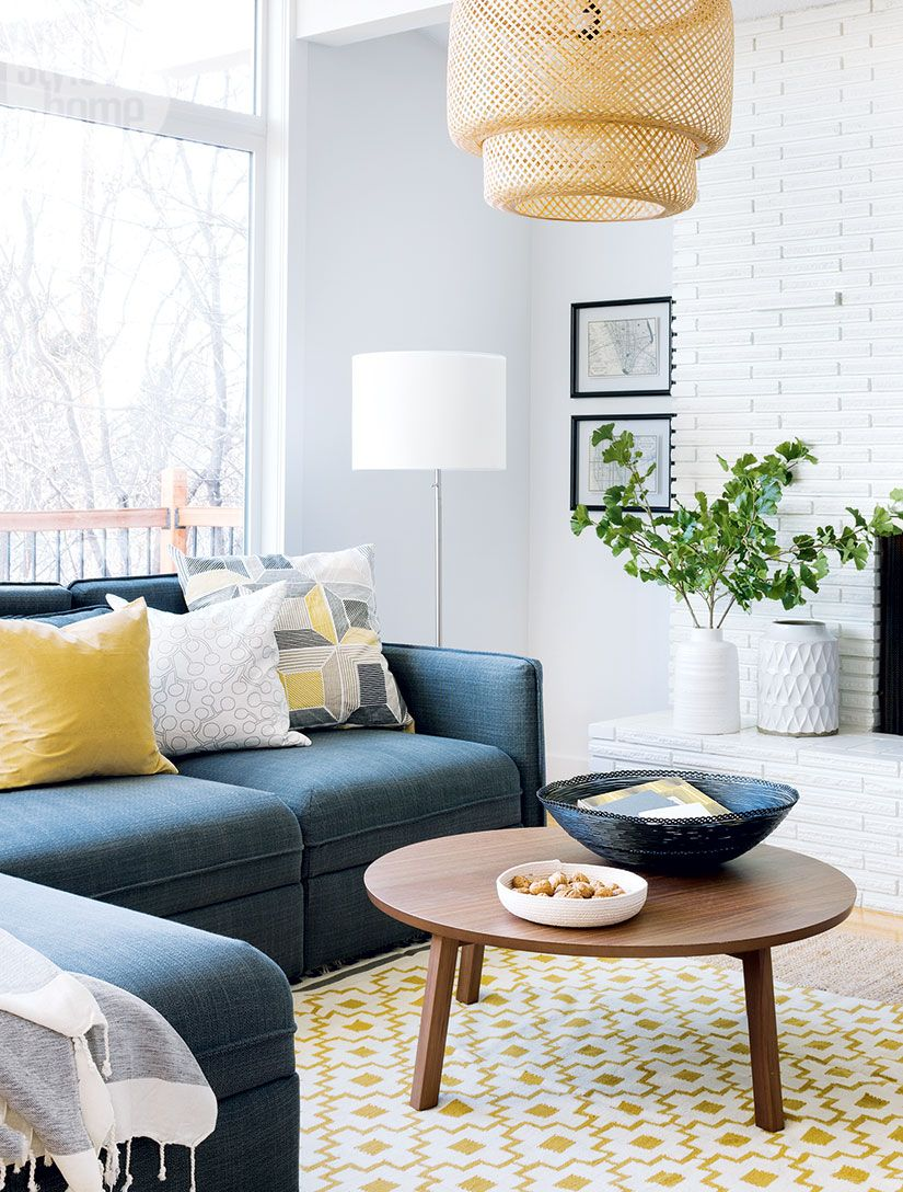 A Scandinavian-inspired living room with a light neutral palette ...