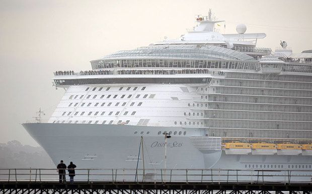 The world's largest cruise ship, MS Oasis of the Seas, owned by Royal Carribbean, makes her way up Southampton Water into Southampton