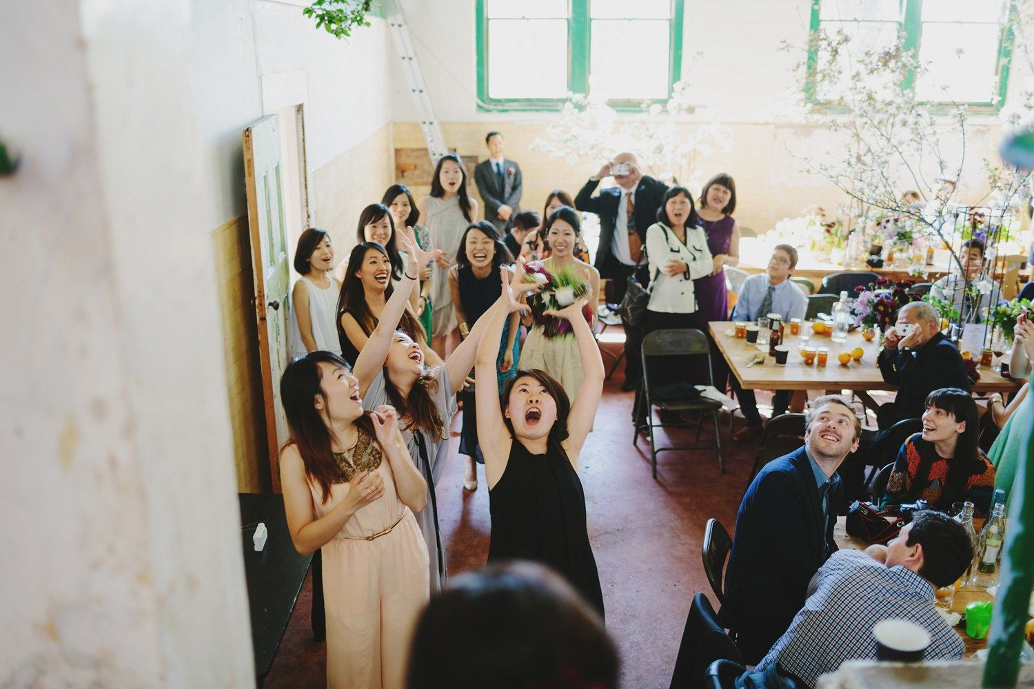Bouquet toss | fabmood.com #wedding #rusticwedding #factorywedding
