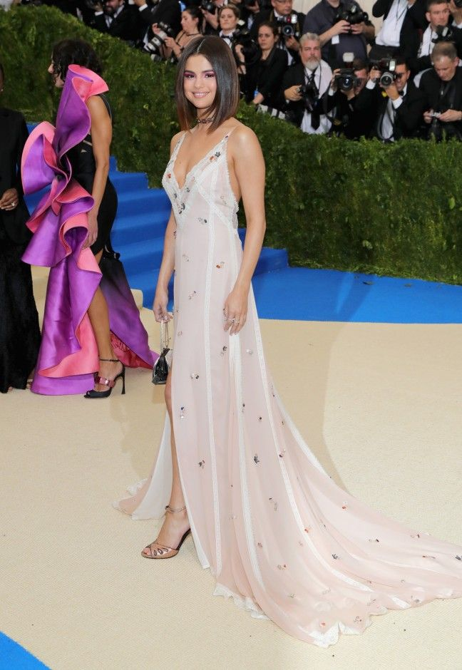 Met Gala 2017 Celebrity Red Carpet Outfits: Met Gala 2017 Celebrity Red Carpet Outfits: The 2017 Met Gala red carpet is officially happening, and we would never dream of letting you miss a single standout look. We'll be here all night gathering the most out-there and most beautiful looks of the night. -- Selena Gomez, MetGala2017, ivory dress with flowers. | Coveteur.com