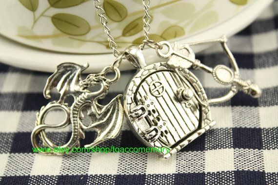 The Hobbit necklace smaug jewelry with arrow $6.99! The door is a locket! I'm ordering this soon!!!!!